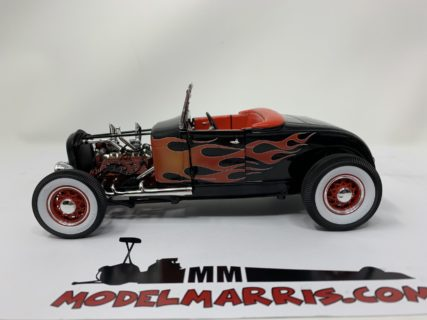 Ford Description: 1929 Ford Hot Rod, black on red with flames